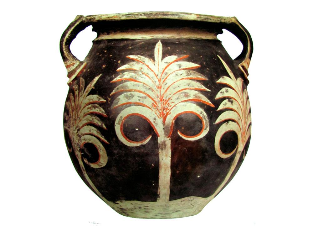Εικ. 2: Πιθαράκι με λευκούς φοίνικες σε μαύρο φόντο. Κνωσός, τέλος Παλαιοανακτορικής περιόδου (Δημοπούλου-Ρεθεμιωτάκη Ν., Το Αρχαιολογικό Μουσείο Ηρακλείου, Αθήνα 2005, σ. 257).