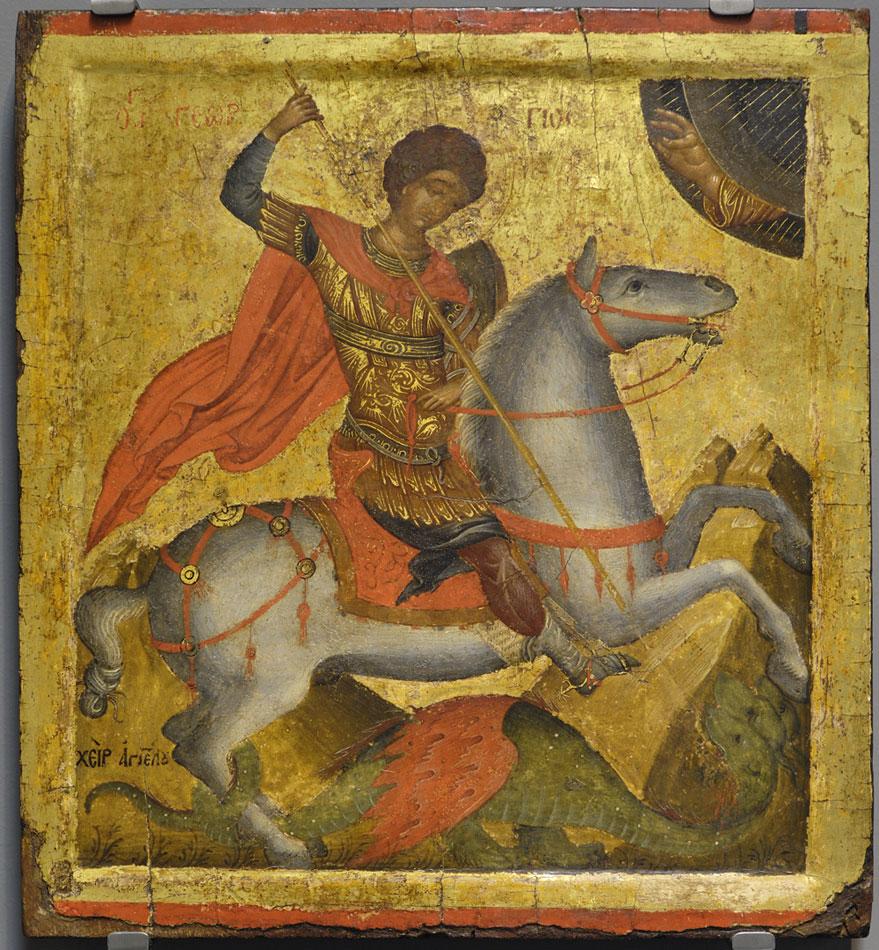 Ο άγιος Γεώργιος, έφιππος δρακοντοκτόνος. Η εικόνα φέρει την υπογραφή του ζωγράφου Άγγελου, που έχει ταυτιστεί με τον διάσημο κρητικό ζωγράφο Άγγελο Ακοτάντο, ο οποίος έζησε και δημιούργησε στον Χάνδακα της Κρήτης το πρώτο μισό του 15ου αιώνα. Δεύτερο τέταρτο 15ου αι. 0,41x0,37 μ. Αποκτήθηκε με τη συνδρομή του Ιδρύματος Α.Γ. Λεβέντη. Μουσείο Μπενάκη (ΓΕ 28129).