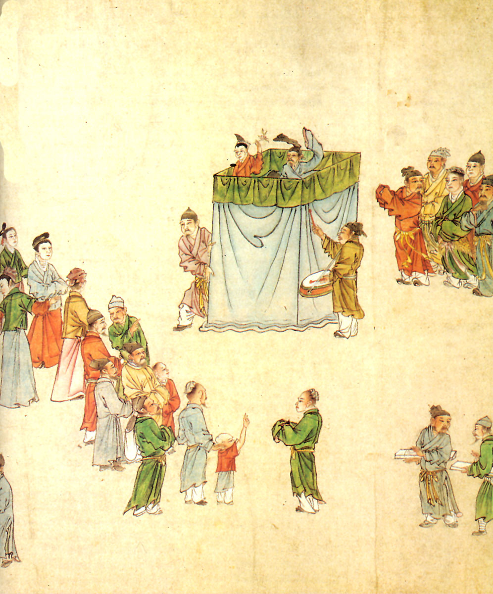 Εικ. 4. Μια πολύχρωμη τοιχογραφία σε μνήμα αξιωματούχου της περιόδου των Τανγκ. Απεικονίζει ομάδα ατόμων σε συμπόσιο, που από την περιβολή τους φαίνεται πως είναι άνθρωποι του πνεύματος. Αξίζει ακόμη να σημειωθεί ότι κάθονται, για πρώτη φορά, σε πάγκους, καθώς μέχρι τότε τους φιλοξενούσε αποκλειστικά και μόνο το πάτωμα.