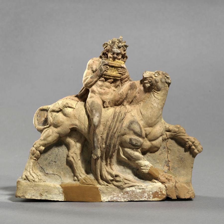 Σάτυρος πάνω σε πάνθηρα που παίζει σύριγγα. 250-200 π.Χ. Σαμοθράκη.