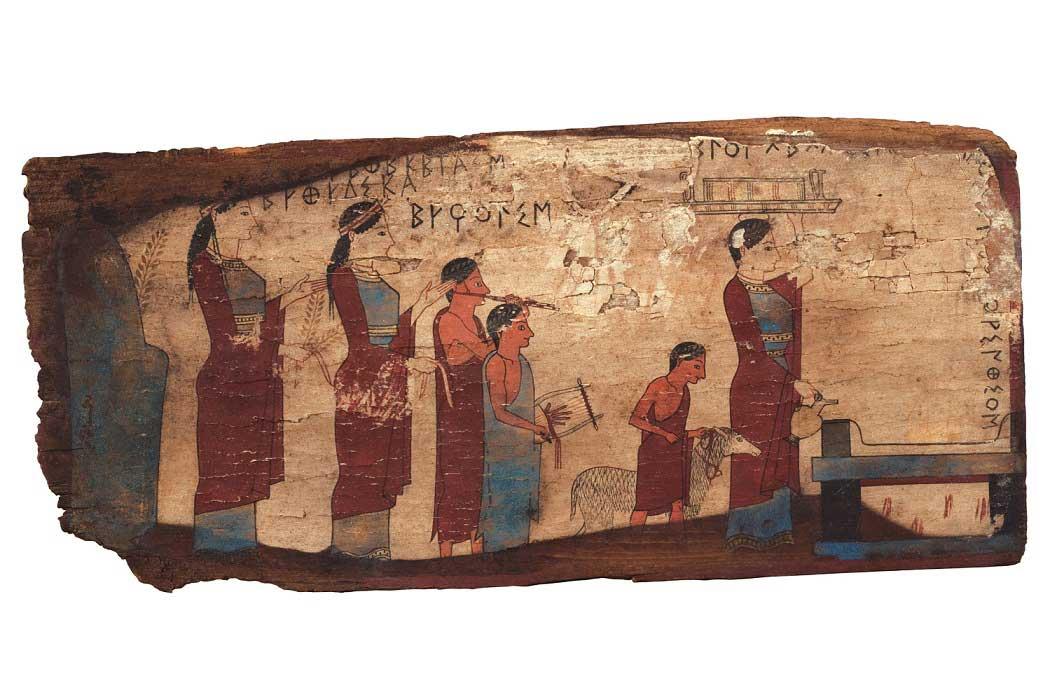 Ξύλινος πίνακας από το σπήλαιο Πιτσά της Κορινθίας με παράσταση πομπής προς το βωμό για τη θυσία αρνιού, με συνοδεία αυλού και λύρας. 540-530 π.Χ. (© Εθνικό Αρχαιολογικό Μουσείο/TAΠΑ).
