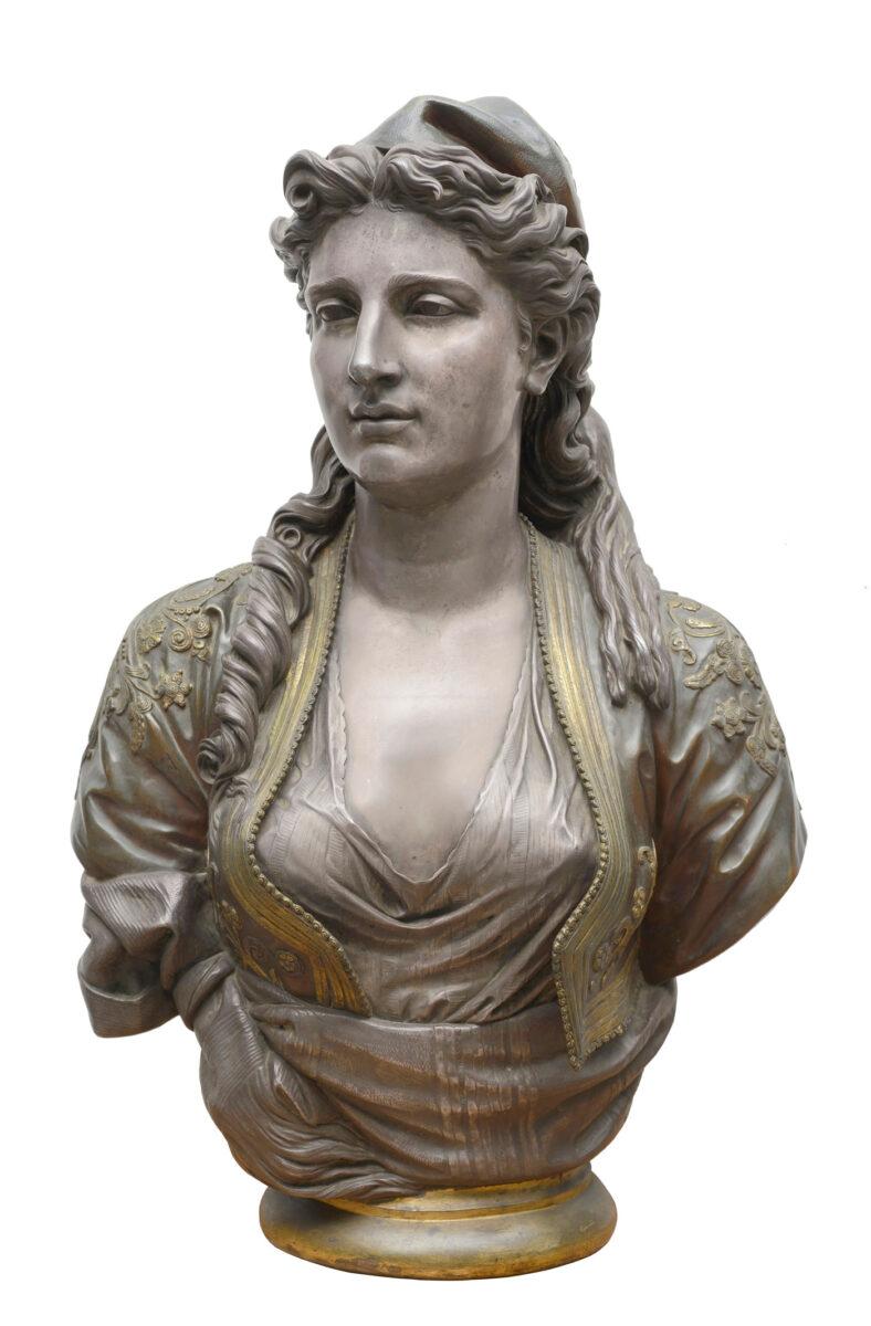 Charles-Henri-Joseph Cordier (1827-1905), «Ελληνίδα, 1873». Μπρούντζος επιχρυσωμένος, επαργυρωμένος και επισμαλτωμένος. Ύψος 75 εκ., μήκος 45 εκ., διάμετρος βάσης 21 εκ. Συλλογή Θανάση και Μαρίνας Μαρτίνου.