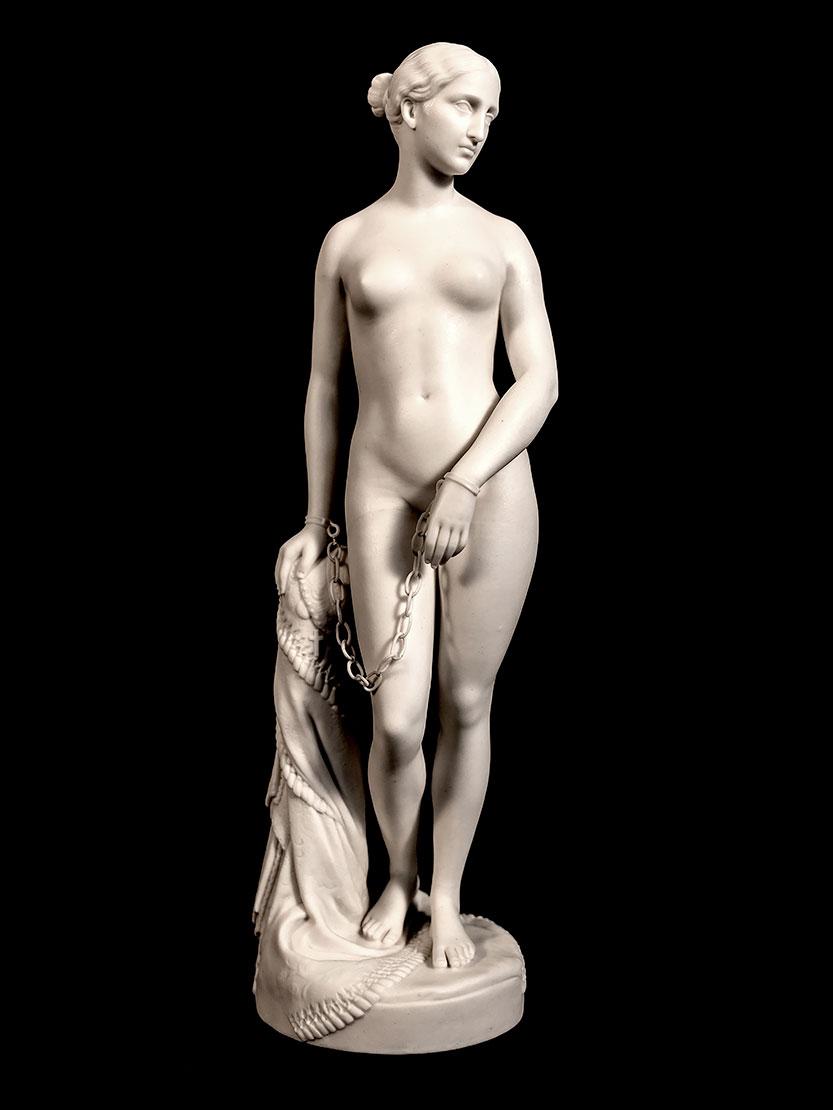 «Η Ελληνίδα Σκλάβα». Παριανή πορσελάνη της εταιρείας Minton, αντίγραφο του διάσημου αγάλματος του Αμερικανού γλύπτη Hiram Powers (1848). Ύψος 35,5 εκ. (φωτ.: Γεννάδειος Βιβλιοθήκη).