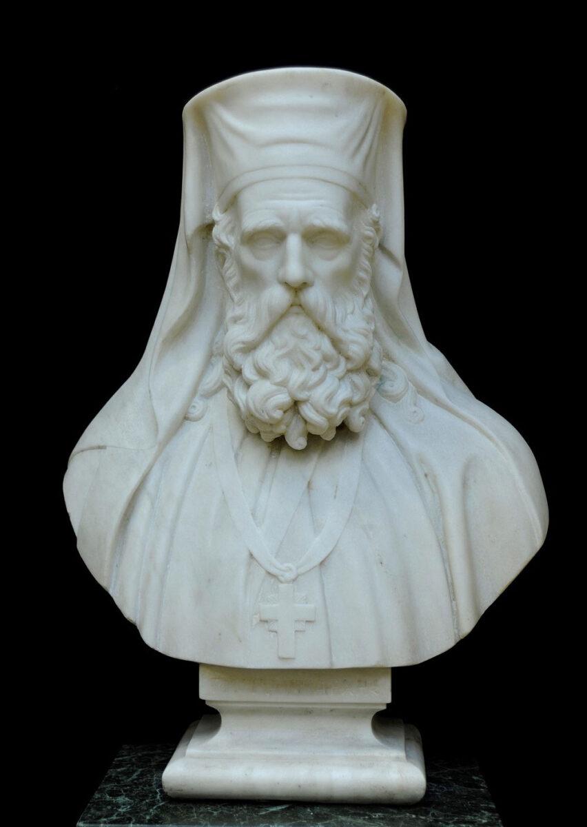 Προτομή Πατριάρχη Γρηγορίου Ε΄, έργο Ιωάννη Κόσσου. μαρμάρινη προτομή, 1863 (ΕΙΜ 2320). Ο Δημητσανίτης Γρηγόριος Ε΄ ήταν μια ισχυρή θρησκευτική και εθνική φυσιογνωμία, ηγέτης του συνόλου των ορθοδόξων ραγιάδων της Αυτοκρατορίας. Οι Οθωμανοί τον απαγχόνισαν στην κεντρική πύλη του Πατριαρχείου, ανήμερα το Πάσχα του 1821, εν μέσω εκτεταμένων σφαγών στην Κωνσταντινούπολη. © ΙΕΕΕ-ΕΙΜ.